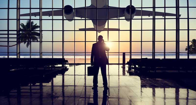 bigstock-Businessman-Airport-Travel-Wai-82325480